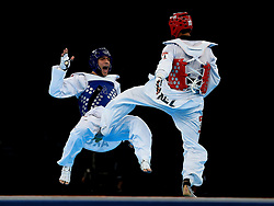 File photo dated 10-08-2012 of Argentina's Sebastian Eduardo Crismanich is kicked by New Zealand's Vaughn Scott in the Men's -80kg Preliminary Round