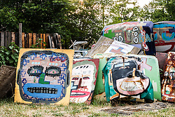Painted car hoods, Heidelberg Project, Detroit, Michigan.  The Heidelberg Project is a grass roots project started by artist Tyree Guyton that uses art to help revitalize the embattled neighborhood.  Each year, over 275,000 people visit the project .  For more information, go to www.heidelberg.org