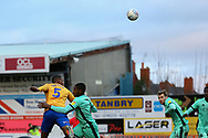 Mansfield Town defender Krystian Pearce (5) wins a header during the EFL Sky Bet League 2 match between Mansfield Town and Carlisle United at the One Call Stadium, Mansfield, England on 1 February 2020.