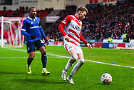 Alfie May of Doncaster Rovers (19) has Gevaro Nepomuceno of Oldham Athletic (27) at his back during the The FA Cup fourth round match between Doncaster Rovers and Oldham Athletic at the Keepmoat Stadium, Doncaster, England on 26 January 2019.