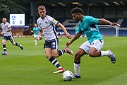 Forest Green Rovers Reuben Reid(26) takes on Bury's Will Aimson during the EFL Sky Bet League 2 match between Bury and Forest Green Rovers at the JD Stadium, Bury, England on 18 August 2018.