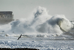 © Licensed to London News Pictures. 03/01/2018. Hayling Island, UK. Strong winds bring high waves to the sea front at Hayling Island as Storm Eleanor hits the south. Winds of up to 80 mph are being forecast today in parts of the UK. Photo credit: Peter Macdiarmid/LNP