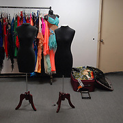 A booth of ballroom dancing costumes, from the Design to Shine by Maria McGill line, is being set up the morning 5 Boro Dance Challenge, May 5, 2007...The locally produced 5 Boro Dance Challenge, New York City's first major same-sex dance competition, was held at the Park Central Hotel in Manhattan from May 4-6, 2007. ..This was the first time that the company was a vendor at a same-sex dancing competition. ....