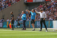 Forest Green Rovers assistant manager, Scott Lindsey and Forest Green Rovers manager, Mark Cooper give instructions during the Vanarama National League Play Off Final match between Tranmere Rovers and Forest Green Rovers at Wembley Stadium, London, England on 14 May 2017. Photo by Shane Healey.