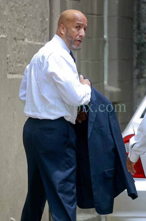 09 July 2014. New Orleans, Louisiana. <br /> A forlorn Ray Nagin, former mayor of New Orleans leaves his attorney's office in New Orleans following his sentencing hearing. Nagin was sentenced to serve 10 years in prison for bribery and money laundering. <br /> Photo; Charlie Varley/varleypix.com