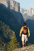 Young man backpacking in Yosemite National Park, CA