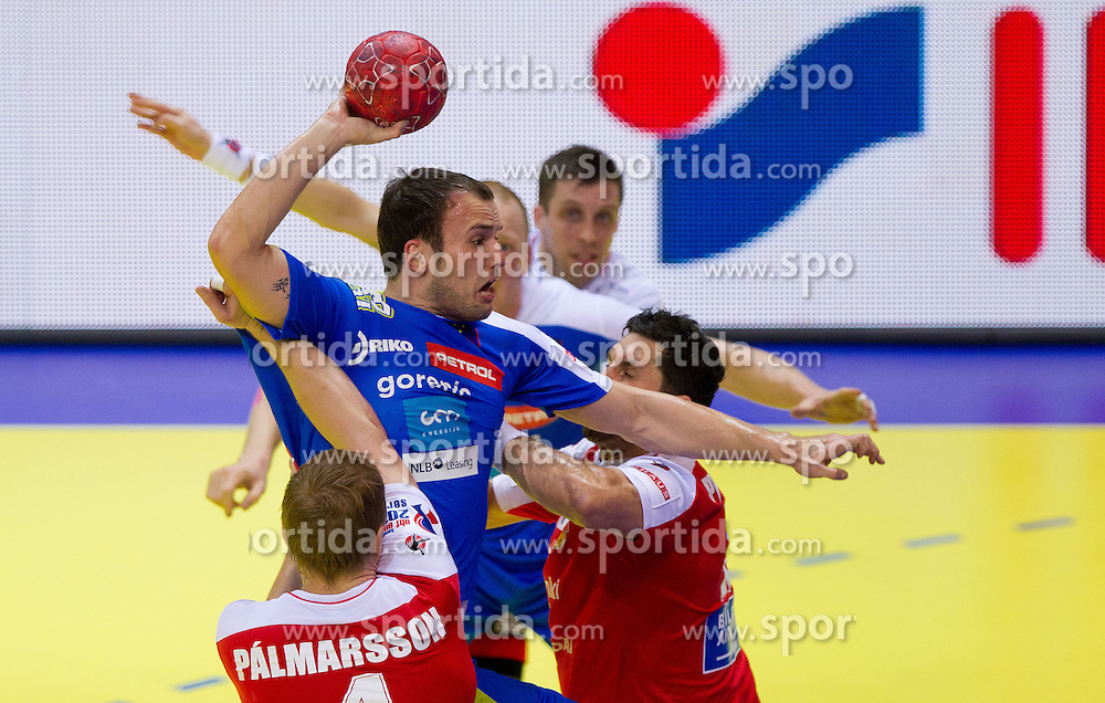 Uros Zorman of Slovenia vs Aron Palmarsson of Iceland and Alexander Petersson of Iceland during handball match between Iceland and Slovenia in  3rd Round of Preliminary Round of 10th EHF European Handball Championship Serbia 2012, on January 20, 2012 in Millennium Center, Vrsac, Serbia.  (Photo By Vid Ponikvar / Sportida.com)