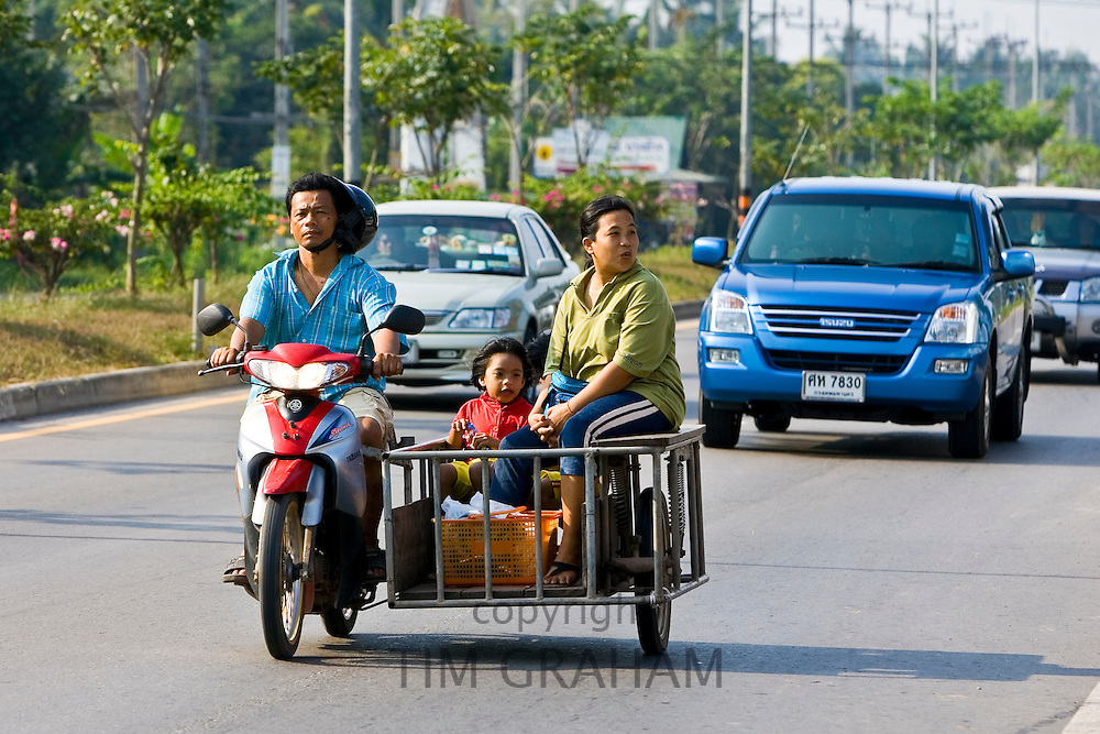 Family travel on a motorcycle and in a side trailer, Bangkok, Thailand
