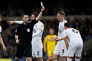 Ben White of Peterborough United receives a yellow card during the EFL Sky Bet League 1 match between Oxford United and Peterborough United at the Kassam Stadium, Oxford, England on 16 February 2019.