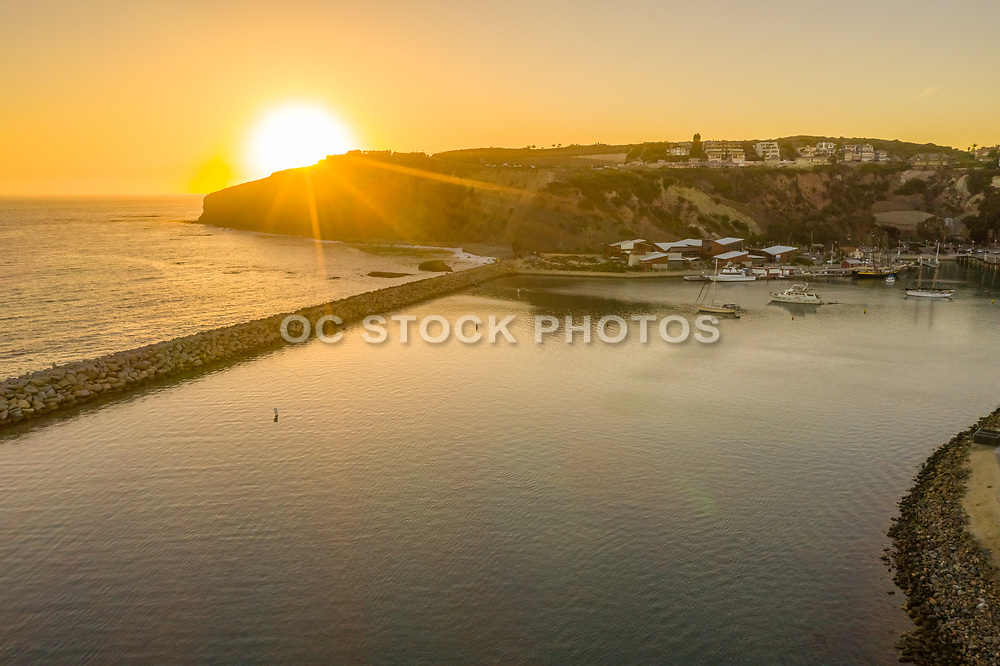 Aerial Photo of Sun Setting Over the Dana Point Bluffs