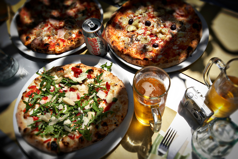 Pizzas and beer from Pizzeria Donna Stella in Amalfi, Italy.