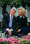 US President Bill Clinton listens to first lady Hillary Clinton during an event at the White House March 22, 1997 in Washington, DC.