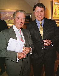 Left to right, MR FELIX FRANCIS and his father top selling author DICK FRANCIS at an exhibition in London on 13th April 1999.MPZ 19