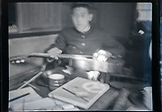 blurry portrait of a student holding an acoustic guitar Japan ca 1940s