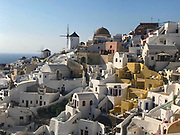 Beautiful afternoon view of Oia, Santorini, Greece. White village with windmill in distance