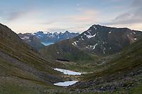 View across isolated mountain valley towards Hustind mountain peak, Flakstadøy, Lofoten Islands, Norway