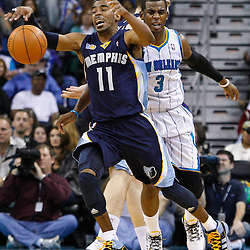 January 19, 2011; New Orleans, LA, USA; Memphis Grizzlies point guard Mike Conley (11) loses the ball as New Orleans Hornets point guard Chris Paul (3) defends during the third quarter at the New Orleans Arena. The Hornets defeated the Grizzlies 130-102 in overtime.  Mandatory Credit: Derick E. Hingle