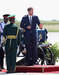 Prince Harry is given a guard of honour as he prepares to leave Grantley Adams International Airport in Barbados as he heads to Guyana, as part of his tour of the Caribbean.