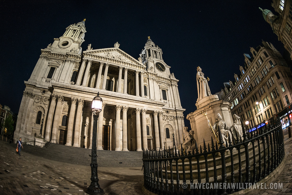 Wide-angle night photo of St Paul's Cathedral, one of the most distinctive of London's landmarks. There has been a church on this site since 604 AD. The current building, with it's massive dome, was designed by Christopher Wren and dates back to the late 17th century. In the foreground is a large statue of Queen Victoria.