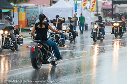 More rain downtown during the annual Sturgis Black Hills Motorcycle Rally. SD, USA. August 5, 2014.  Photography ©2014 Michael Lichter.