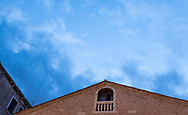 Evening blue skies and misty clouds passing over Camp San Toma in Venice, Italy
