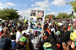 878<br /> 13.04.2018<br /> Mourners sing hymes outside the Kupane Funeral Parlour as they wait for Winnie Madikizela-Mandela's body to be collected in Orlando West, Soweto.<br /> Picture: Itumeleng English/ African News Agency(ANA)<br /> 878<br /> 13.04.2018