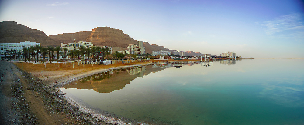 Panoramic view of Hotels and a reflection in the Dead Sea, Israel as seen from south