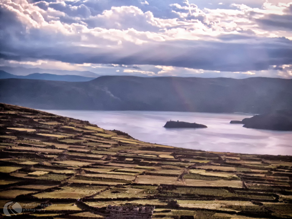 There's no electricity nor cars on Amantani Island, yet its villagers  grow manicured fields of crops for their food.  Families offer housing & meals for visitors to experience life on a remote island in the middle of a very large lake.  The boat trip to the island is about 4 hours from Puno, Peru.