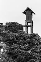 61. Hashima Island 端島炭坑 once had a population of 5000 coal miners, but was abandoned in 1974. The island was left to the elements, now serving as a time capsule of the past.  A cameo role in the 007 James Bond Skyfall movie put it back on the map.  It is often called Gunkanjima or Battleship Island because of its shape.  Before the place became famous, it was slated to become a huge trash pit, but preservationists put a stop to that plan.  Alighting from the boat onto the island is like entering a sci-fi scenario with its crumbling and ruined concrete apartment buildings and collapsing brick stairways, twisted metal girders and plant life growing in the cracks.  Access to many of the sites on the island are prohibited because of safety reasons.