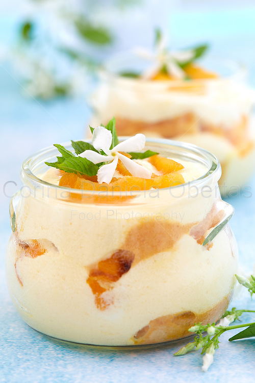 Closeup of bowls with apricot tiramisu on a table in pastel colors with jasmine flowers. Sold exclusively through Stockfood.com
