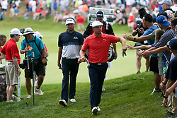 June 24, 2018 - Cromwell, Connecticut, United States - Bubba Watson (L) and Bryson DeChambeau approach the 18th tee during the final round of the Travelers Championship at TPC River Highlands. (Credit Image: © Debby Wong via ZUMA Wire)