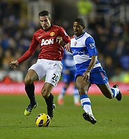 Football - Barclays Premier League - Reading vs. Manchester United<br /> Mikele Leigertwood of Reading and Robin van Persie of Manchester United in action at the Madejski Stadium, Reading