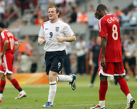 Photo: Chris Ratcliffe.<br /> England v Trinidad & Tobago. Group B, FIFA World Cup 2006. 15/06/2006.<br /> Wayne Rooney is all smiles as he gets on.