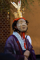 Midwife at Mengake Kamakura - Mengake or Masked Parade at Goryo Jinja shrine.  At this festival held in September a group of ten people take part in this annual ritual: 8 men and 2 women. Wearing comical or grotesque masks that signify different demons, legends and dieties  leave the shrine and parade through the nearby streets accompanied by portable shrine and festival music.