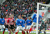 Photograph: Scott Heavey.<br />Southampton v Portsmouth. FA Barclaycard Premiership. 21/12/2003.<br />Jason Dodd's corner beats everyone to open the scoring