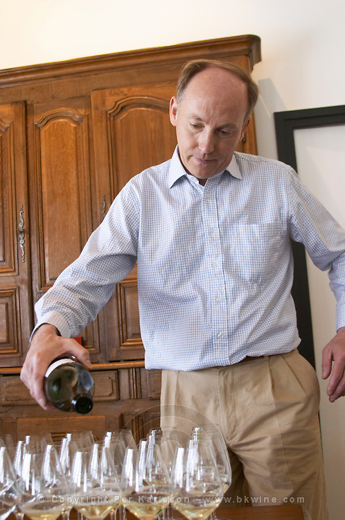 Herve Jestin, oenologist and chief winemaker pouring champagne for tasting Champagne Duval Leroy, Vertus, Cotes des Blancs, Champagne, Marne, Ardennes, France