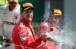 Ferrari's Sebastian Vettel celebrates his victory in the 2018 British Grand Prix at Silverstone Circuit, Towcester.