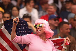 April 7, 2018 - Hong Kong, CHINA - An American woman dressed in fancy wig wave Old Glory from the stand cheering for American team at Hong Kong Rugby Sevens.Apr-7,2018 Hong Kong.ZUMA/Liau Chung Ren (Credit Image: © Liau Chung Ren via ZUMA Wire)