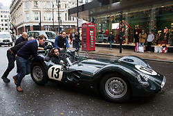 London, UK. 29th November, 2018. Auctioneers Bonhams move a 1959 Lister-Jaguar 'Knobbly' 3.8-Litre Sports-Racing Two-Seater (£2,200,000-2,800,000), one of the highlights of  an auction of historic and high-performance racing and road cars. Other highlights include a Le Mans class-winning Jaguar XJ220C driven by David Coulthard (£2,200,000-2,800,000) and a 1958 BMW 507 owned by its designer, as well as Ferraris, Aston Martins, Bentleys, Porsches and Jaguars. Bonhams, founded in 1793, is one of the world's largest and most renowned auctioneers of fine art and antiques, motor cars and jewellery.