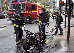 """© under license to London News Pictures. 15/04/11. John Mathers was on his way to work when his Gilera motorbike went up in flames on Tottenham court road this morning. Thick black smoke could be seen bellowing from the scene. One appliance from London Fire Brigades nearby Euston attended extinguishing the fire very quickly..Mr Mathers said """"I was going to cycle in this morning, but decided to take the bike (motorbike)"""" adding """"I didn't know the bike was on fire untill someone pointed out that it was"""". Thankfully no one was hurt or injured, but the motorbike is a write off, Fire-fighters commented motorbike fires are becoming more common within London. Picture credit should read Simon Lamrock/LNP"""