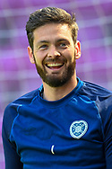Craig Gordon (#1) of Heart of Midlothian FC is all smiles during the warm up before the SPFL Championship match between Heart of Midlothian and Inverness CT at Tynecastle Park, Edinburgh Scotland on 24 April 2021.