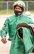 Photo Randy Vanderveen<br /> Grande Prairie, AB<br /> 2020-07-11<br /> Blandford Stewart's mask appears to be advertising the Covid 19 slogan as he rides past during the Parade to the Post during opening day at Evergreen Park's 2020 horse race season opener.