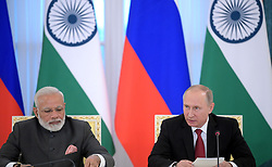 June 1, 2017 - Saint Petersburg, Russia - June 1, 2017. - Russia, Saint Petersburg. - Russian President Vladimir Putin and Indian Prime Minister Narendra Modi (left) at a press conference in the Constantine Palace in Strelna following their meeting at the 2017 St. Petersburg International Economic Forum. (Credit Image: © Russian Look via ZUMA Wire)