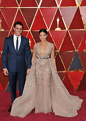 Gina Rodriguez  and Joe Locicero walking on the red carpet during the 90th Academy Awards ceremony, presented by the Academy of Motion Picture Arts and Sciences, held at the Dolby Theatre in Hollywood, California on March 4, 2018. (Photo by Sthanlee Mirador/Sipa USA)