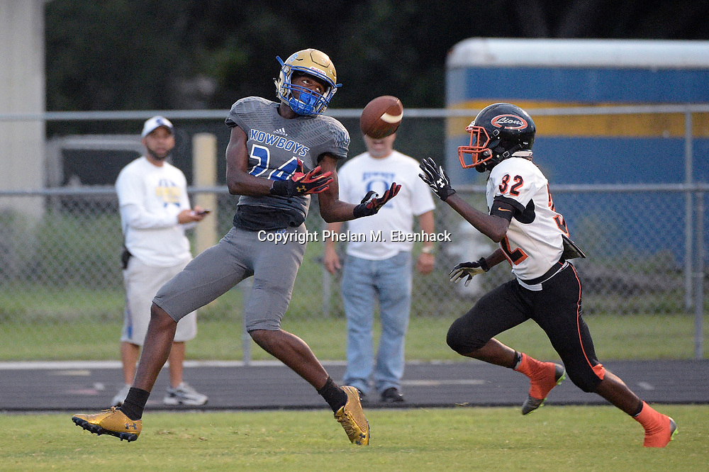 Osceola receiver Fillimore Wynter (24) catches a pass for a touchdown after getting past Oviedo defensive back Markel Lewis (32) during a high school football game in Kissimmee, Fla., Friday, Sept. 2, 2016. (Photo by Phelan M. Ebenhack)