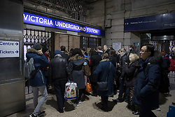 © Licensed to London News Pictures. 10/01/2017. London, UK. Passengers head for the Underground at Victoria Railway Station as a second round of strikes by Southern Rail train drivers starts. Photo credit: Peter Macdiarmid/LNP