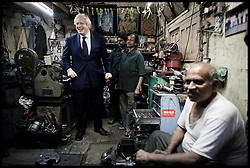 London Mayor Boris Johnson tours a market in Hyderabad, on the Third day of a six-day tour of India, where he will be trying to persuade Indian businesses to invest in London, Tuesday November 27, 2012. Photo by Andrew Parsons / i-Images