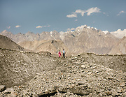 A Wakhi couple, crossing the Ghulkin glacier, upper Hunza. Karakoram mountains.