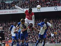 Photo: Olly Greenwood.<br />Arsenal v Blackburn Rovers. The FA Cup. 17/02/2007. Arsenal's Kolo Toure jumps above Blackburn's Stephen Warnock