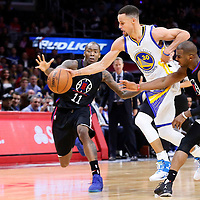 20 February 2016: Golden State Warriors guard Stephen Curry (30) drives past Los Angeles Clippers guard Chris Paul (3) and Los Angeles Clippers guard Jamal Crawford (11) during the Golden State Warriors 115-112 victory over the Los Angeles Clippers, at the Staples Center, Los Angeles, California, USA.